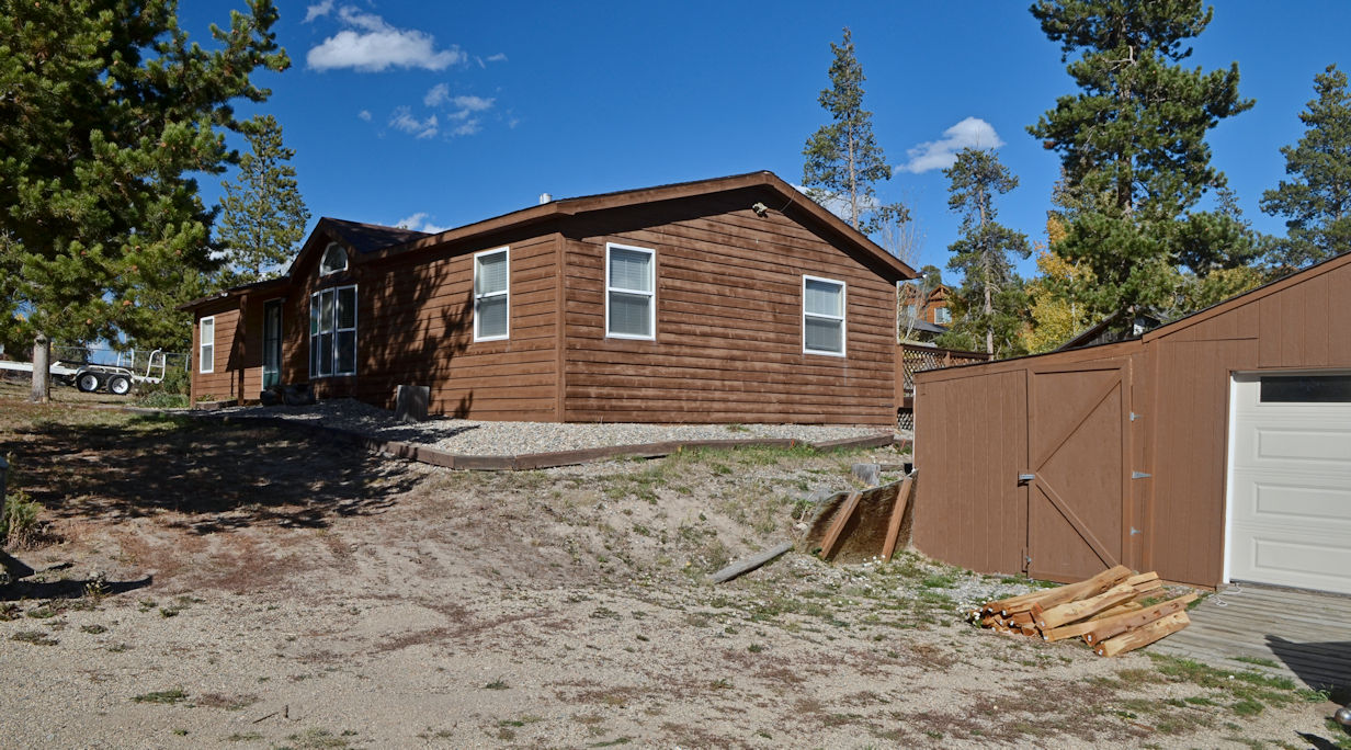 With Storage Building And Fenced Back Yard, Midway Between Grand Lake And  Granby. $285,000 #447 Road 640, Granby. McElwain Lot 5, Block 3 R100850